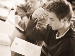 A thoughtful student. What is he thinking about?