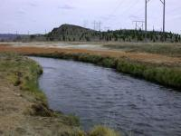 Silver Bow Creek with colored mineral deposits in the floodplain