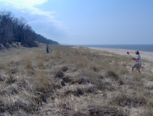 Jon Schmitkons measures erosion pins while Brent Geurink moves to another survey position on the foredune.