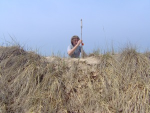 Jon Schmitkons measures an erosion pin at the study area
