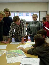 Students working in a group with geologic maps.