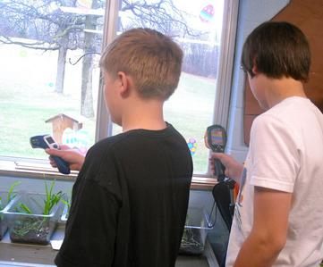 Students measure the temperatures of window materials