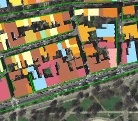 This satellite image has been modified using GIS software to color-code buildings by use.