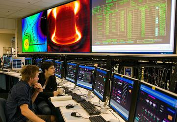 MIT graduate students  monitor the engineering systems in the control room of the Alcator C-Mod tokamak