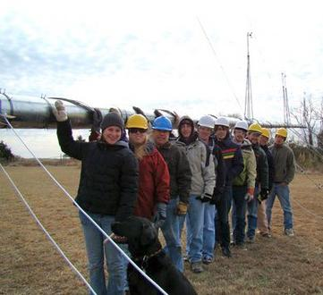Students installing a meteorological tower
