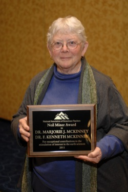 Marjorie McKinney with the Neil Miner Award