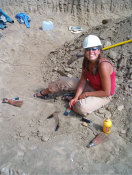 MSU student Vanessa Shaw with two T-rex teeth found in the B-rex quarry.