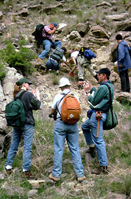 Geologists examining Cambrian strata in the Horseshoe Hills near Bozeman, Montana