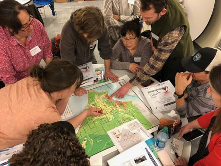 Participants consider seismic hazard zones and vulnerable infrastructure in Anchorage.
