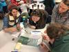 Workshop participants explore hands-on activity to understand tsunami inundation factors.