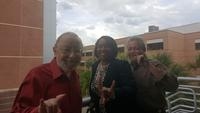 "Dr. Gerry Miesels, Dr. Ruthmae Sears and Dr. Robert Potter proudly promoting USF with ""Go bulls"" hand gesture"