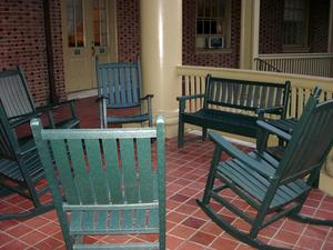 Empty chairs on a portico