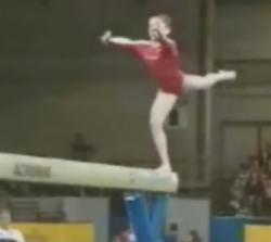 Carly Patterson, young American gymnast, on the balance beam