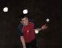 Peter Bone juggling 9 balls, photo by Luke Burrage; cropped