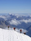 Mountaineers leaving the top station of the Aiguille du Midi.