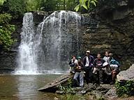 students at waterfall at Hayden Run