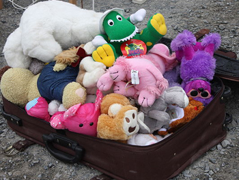 stuffed animals in a suitcase