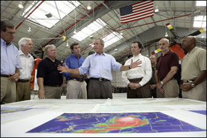 President Bush reviews a map of Hurricane Katrina