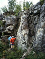 People examine fractured rock