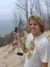 Brent Geurink measures wind conditions at the crest of a dune near the study area..