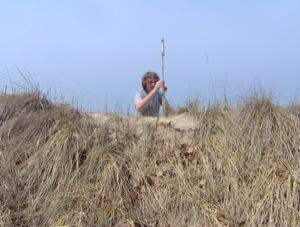 Jon Schmitkons measures an erosion pin at the study area