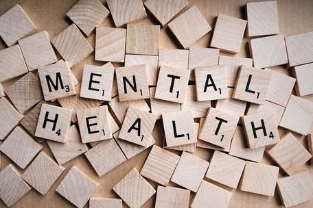 Mental health spelled with Scrabble tiles