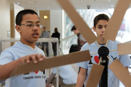 Students build a model wind turbine out of cardboard