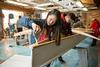 Students building a solar boat