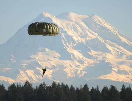 A parachutist descending in Fort Lewis Washington