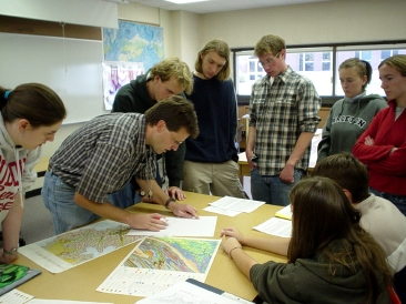 Professor Cam Davidson and a few of his students at Carleton College discussing a map