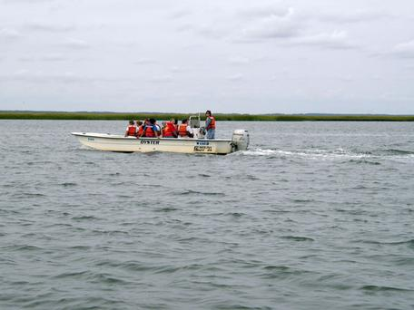 William and Mary geology students in a boat