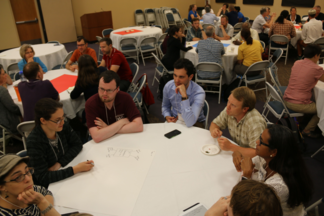 Participants engage in a group discussion at the forum.