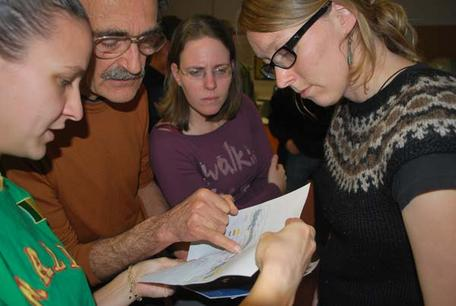 Scientist grouped around map of Haiti earthquake