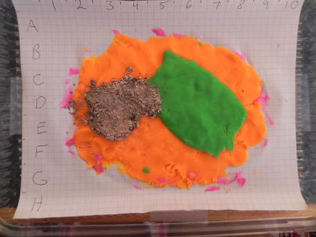 Two layers of PlayDoh in a baking pan.