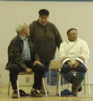 elders speaking at meeting