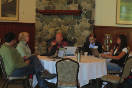 GeoEthics workshop participants work in small groups to review teaching materials.