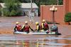 A water rescue team in a boat searching for people in Oklahoma