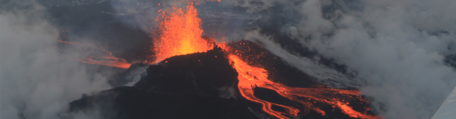 Monitoring Volcanoes module banner. Lava spewing from a opening.