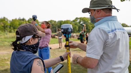Students and instructor use Emlid ReachRS2 GPS receivers in the field near Earlham College.