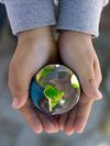 Globe in child\'s hands
