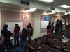 students in small class engaged in gallery walk