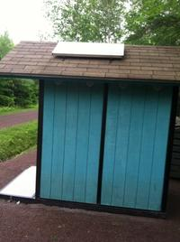 Composting toilet using solar energy for fan