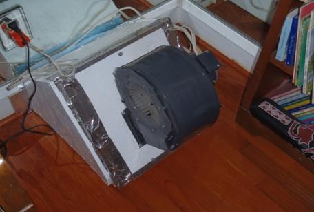 Fan to ventilate solar wall furnace