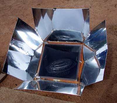 Greenhouse-style cooker with reflectors