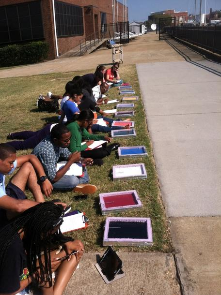 Students testing the effect of color on solar uptake