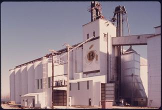 Burdick Elevator for grain storage in New Ulm, Minnesota. The county seat trading center remains predominately a farming community although its growth since 1950 has been due to the arrival of manufacturing firms.