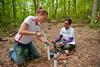 Student measuring soil water pH