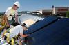 Students installing solar panels