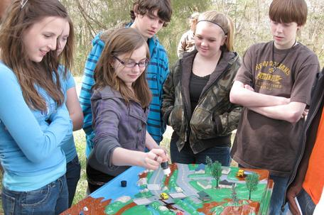 Students learn about pollution through a watershed education program.