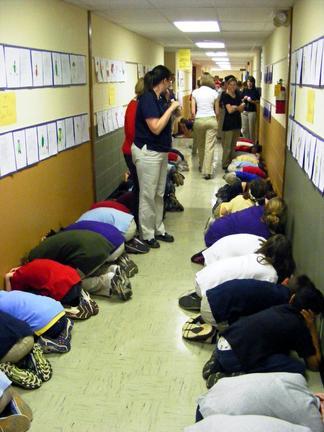 Students participate in a tornado drill